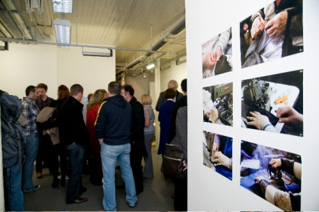 People enjoying a photography exhibition