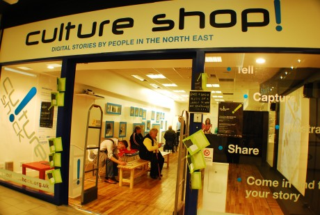 An image of the front of Culture Shop with people interacting inside