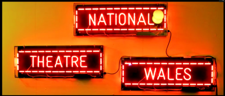 Glowing signs that say National Theatre Wales