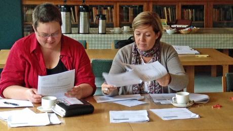 two females reviewing documents